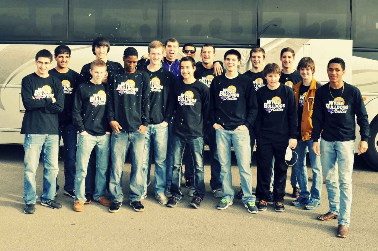 Wylie players gathered in front of a charter bus before leaving for Austin to compete in the state basketball tournament.Photo by Kerr Broadstreet/WylieSports.com