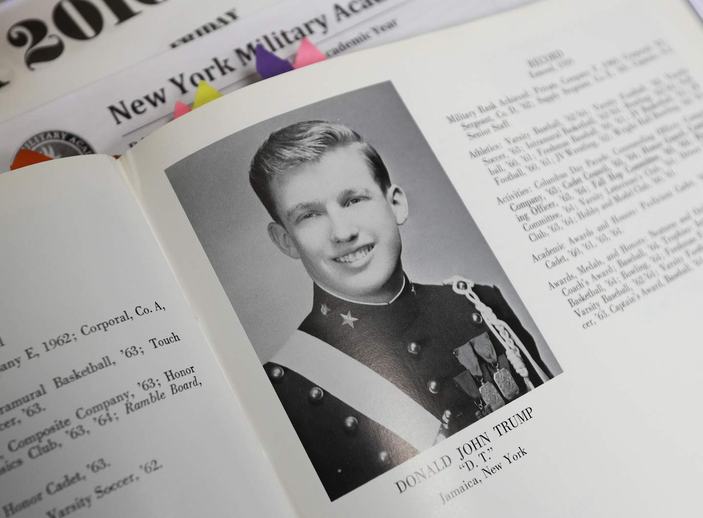 In this Thursday, Sept. 8, 2016 photo, Donald Trump is shown in the 1964 Shrapnel yearbook at the New York Military Academy in Cornwall-on-Hudson, N.Y. Trump talks tough about dealing with China, but his alma mater, the New York Military Academy, is looking to Asia to survive. The school has reopened after a rough patch with new Chinese owners and a new superintendent who emigrated from China before making her mark in the New York City school system. (AP Photo/Mike Groll)