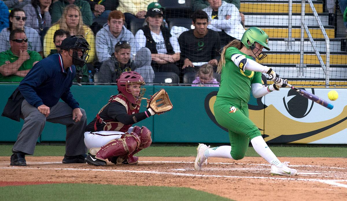 Oregon Ducks Jenna Lilley (#00) swings for the ball. The No. 5 Oregon Ducks defeated the No. 2 Florida State Seminoles in both games of the doubleheader (11-0, 3-1) on Saturday afternoon. This sweep of the first two rounds of the postseason happened in front of a soldout crowd of 2,517 at Jane Sanders Stadium. Photo by Cheyenne Thorpe, Oregon News Lab