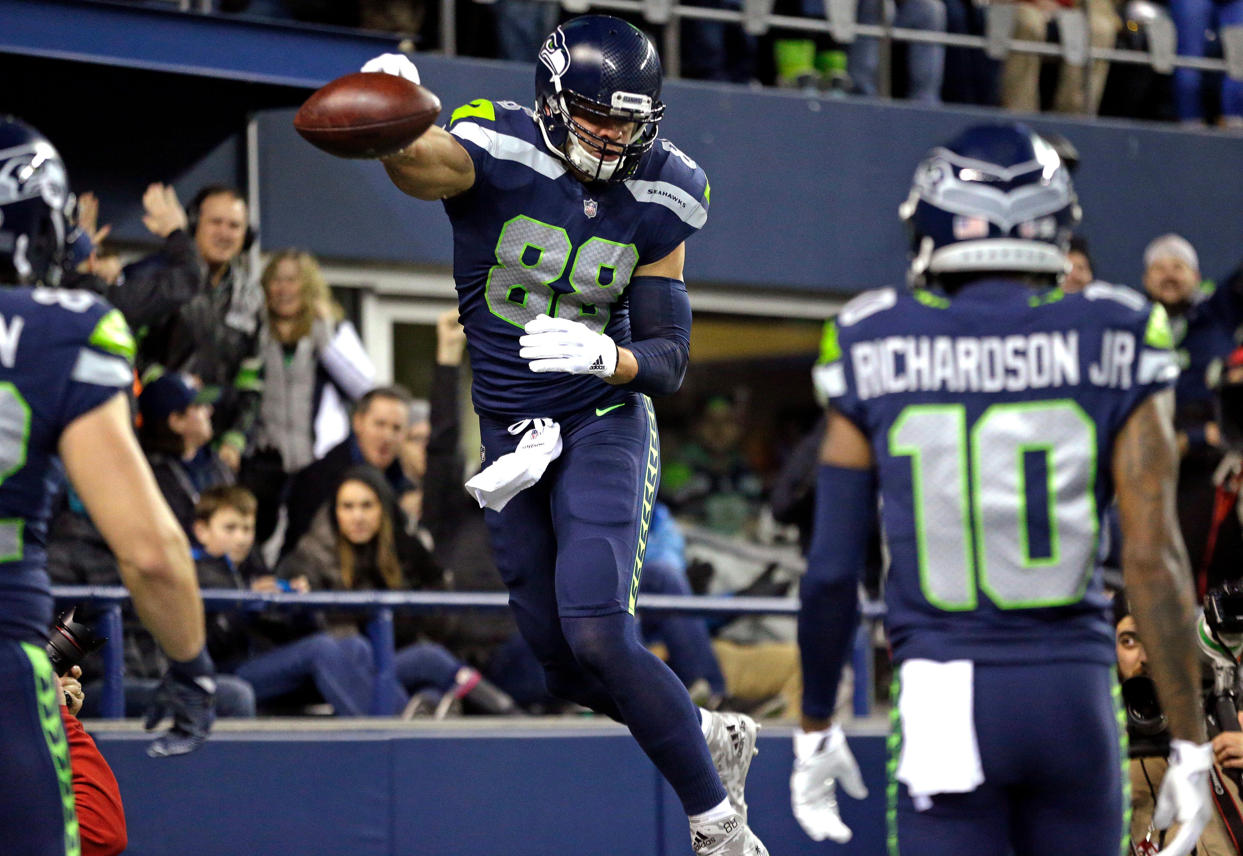Seattle Seahawks' Jimmy Graham leaps to spike the ball after scoring a touchdown on an 11-yard pass reception against the Philadelphia Eagles during the first half of an NFL football game, Sunday, Dec. 3, 2017, in Seattle. (AP Photo/Ted S. Warren)