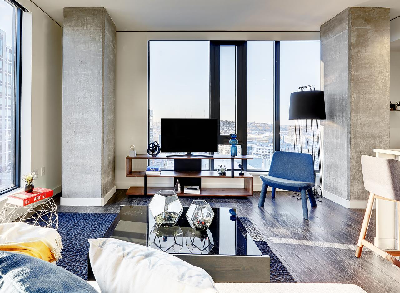 The living area in a two bedroom apartment at AMLI Arc<p></p>