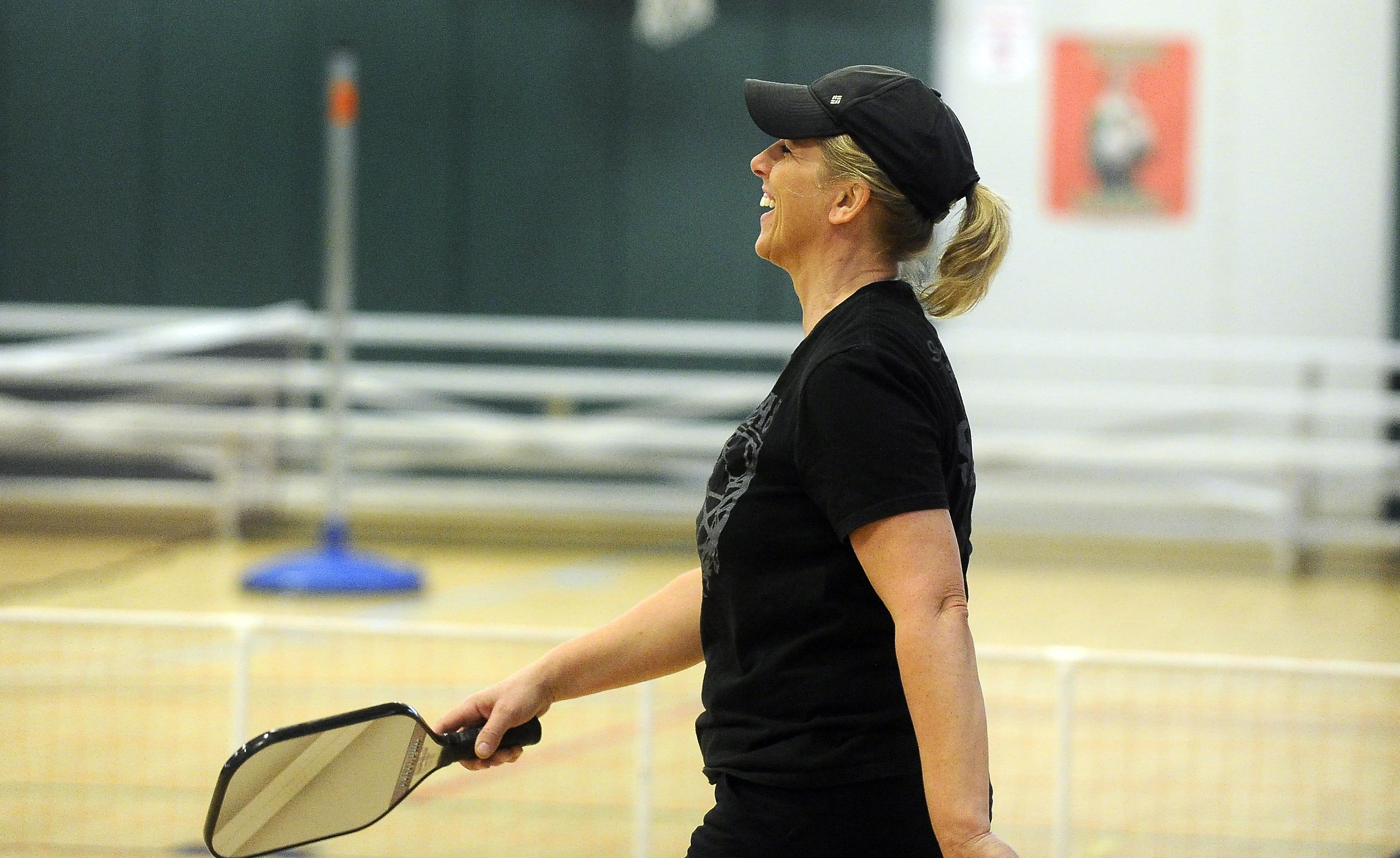 DeAnn Winter of Medford smiles at the conclusion of a match of pickleball at the Santo Center in Medford. [Mail Tribune / Andy Atkinson]