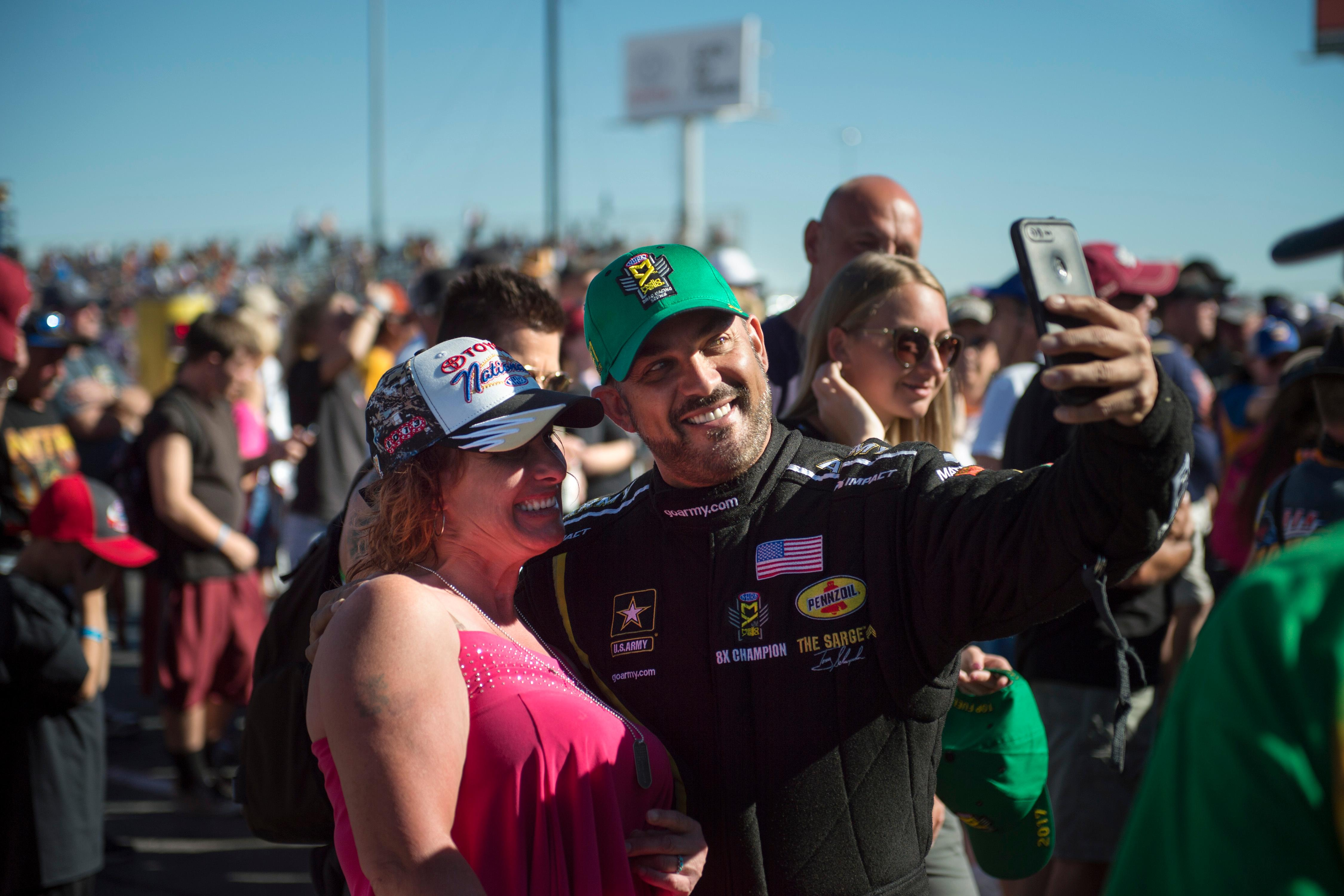 Top Fuel driver Tiny Schumacher takes a selfie with a fan before the start of the NHRA Toyota Nationals Sunday, October 29, 2017, at The Strip at the Las Vegas Motor Speedway. CREDIT: Sam Morris/Las Vegas News Bureau