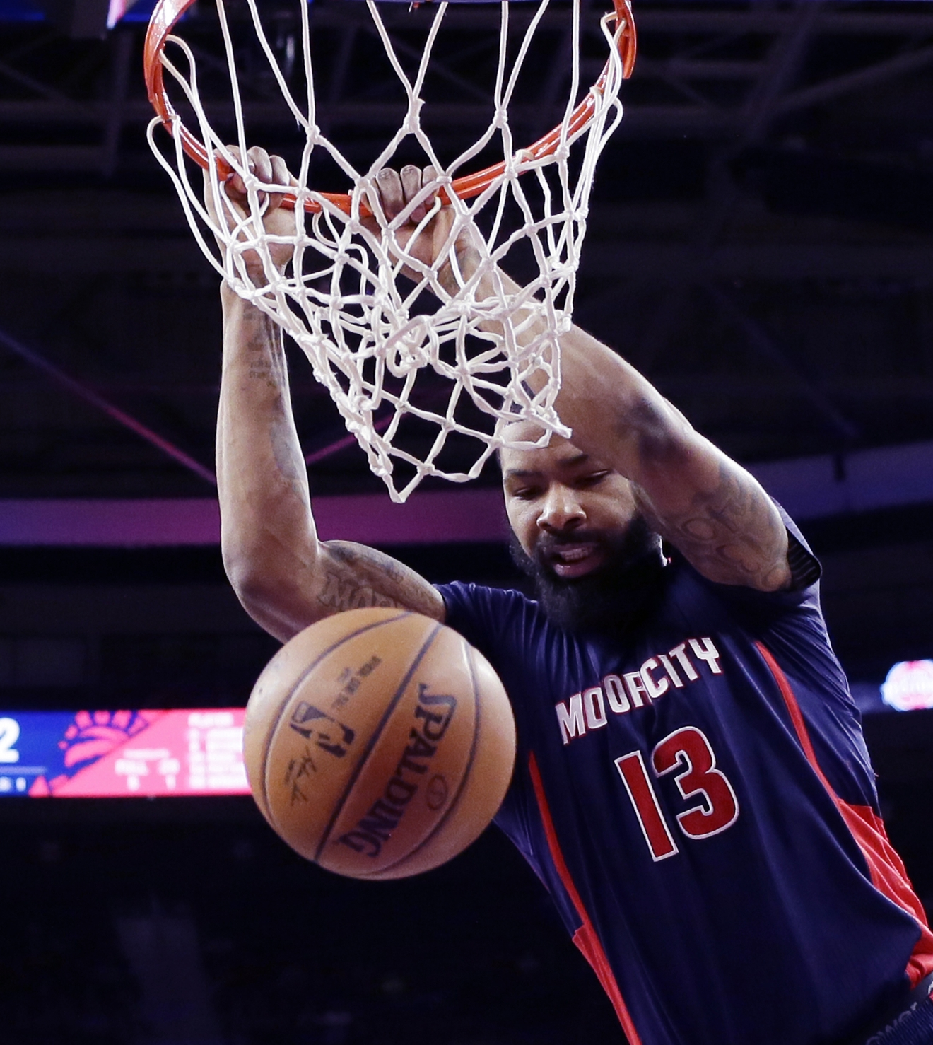 Detroit Pistons forward Marcus Morris dunks during the first half of an NBA basketball game against the Toronto Raptors, Sunday, Feb. 28, 2016, in Auburn Hills, Mich. (AP Photo/Carlos Osorio)