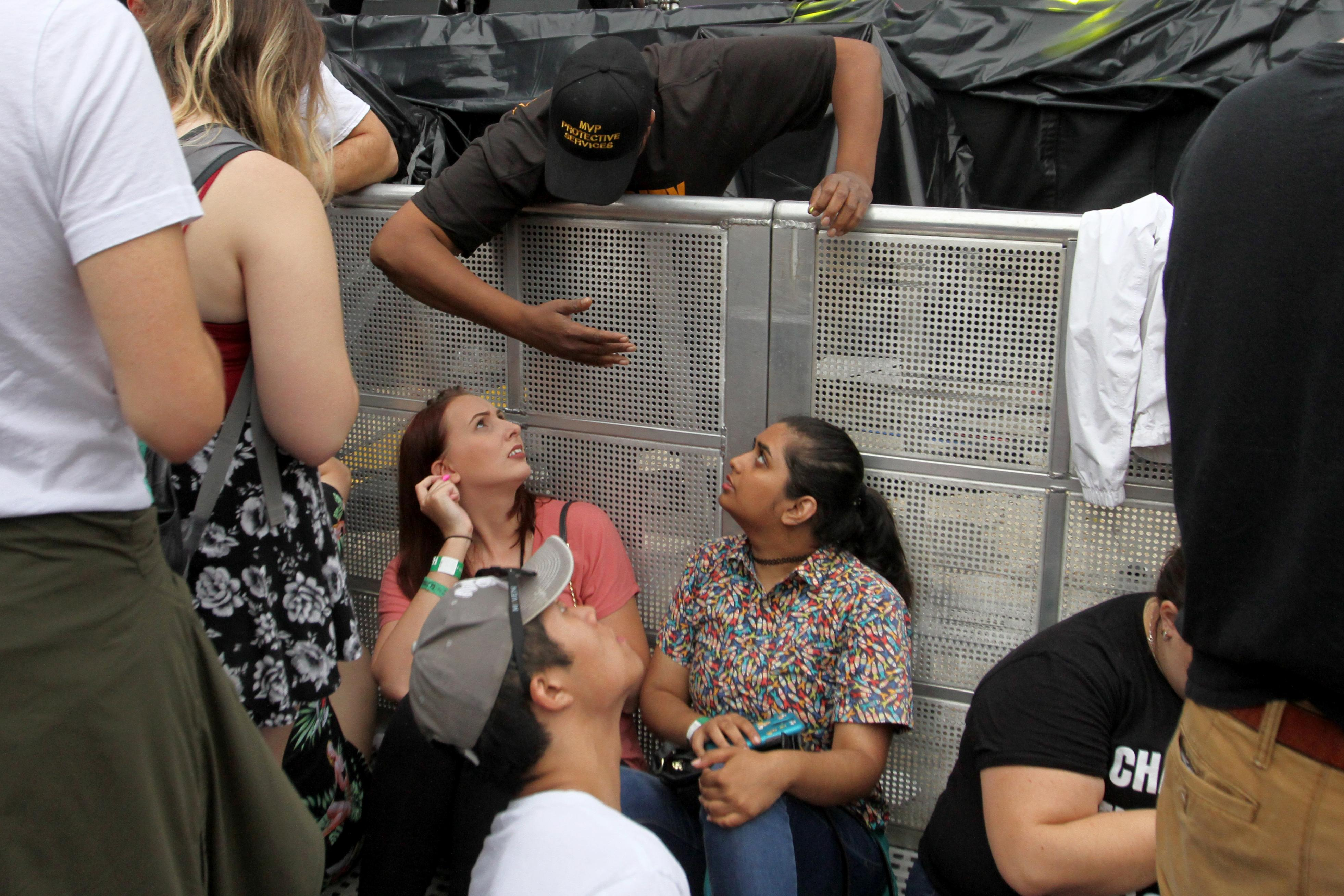 The final day of All Things Go brought the biggest crowds yet. Although Bleachers and Betty Who drew lots of music fans,  rain didn't stop festival-goers from jamming out to headliner Foster The People. After discussing gun violence and the attack in Las Vegas, the band decided not to perform their hit 'Pumped Up Kicks', which is about a school shooting. (Amanda Andrade-Rhoades/DC Refined)