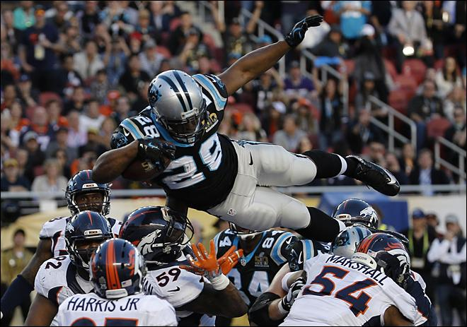 Carolina Panthers Jonathan Stewart (28) scores a touchdown against the Denver Broncos during the first half of the NFL Super Bowl 50 football game Sunday, Feb. 7, 2016, in Santa Clara, Calif. (AP Photo/Matt Slocum)<p></p>
