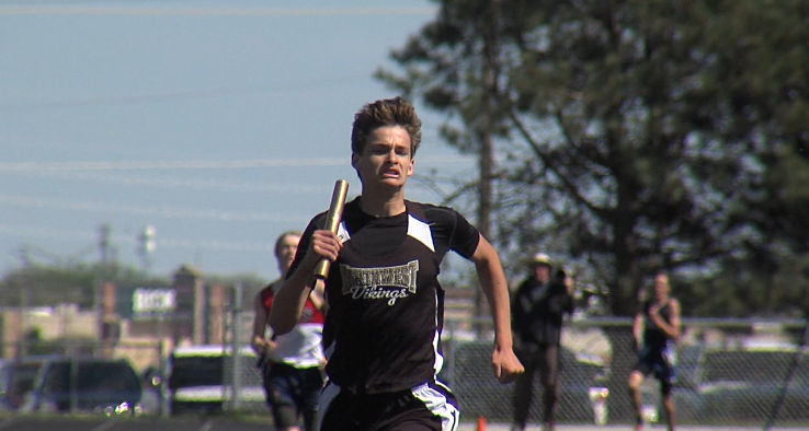 Trevor Fisher completes the anchor leg as Northwest wisn the boys 4x800 meter relay at the Dave Gee Invite, hosted by Northwest High School, April 20, 2017 (NTV News)