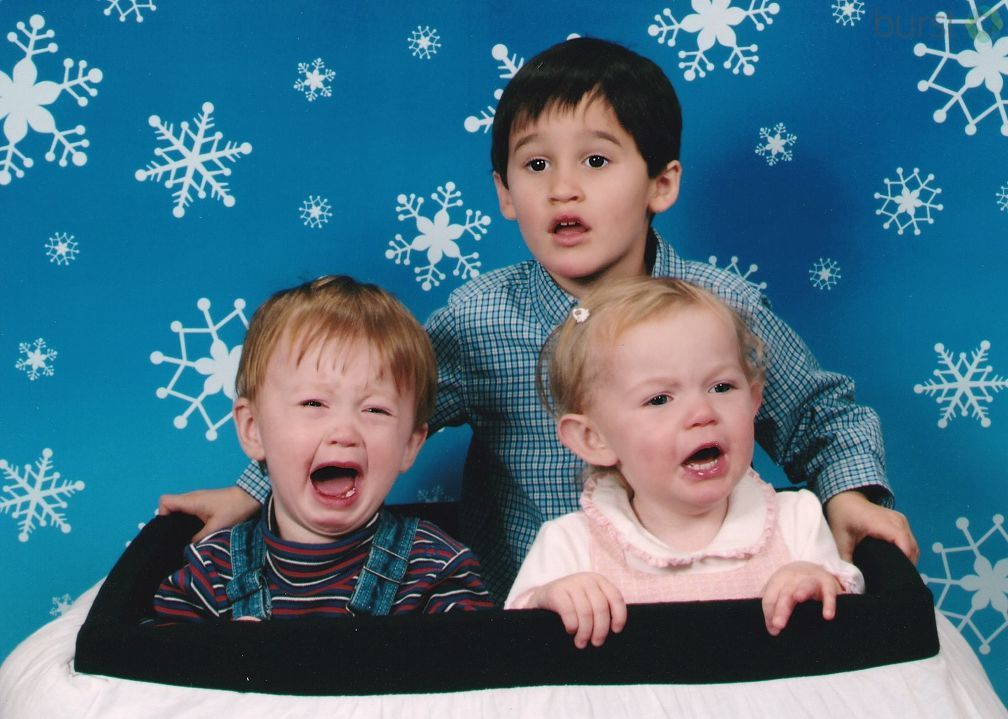 2006 Christmas with cousins:  Sometimes it's not even about Santa,  just not in the mood for a holiday photo. (Photo courtesy of Kara Lambourn)