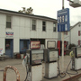Full-serve gas station closes while another opens