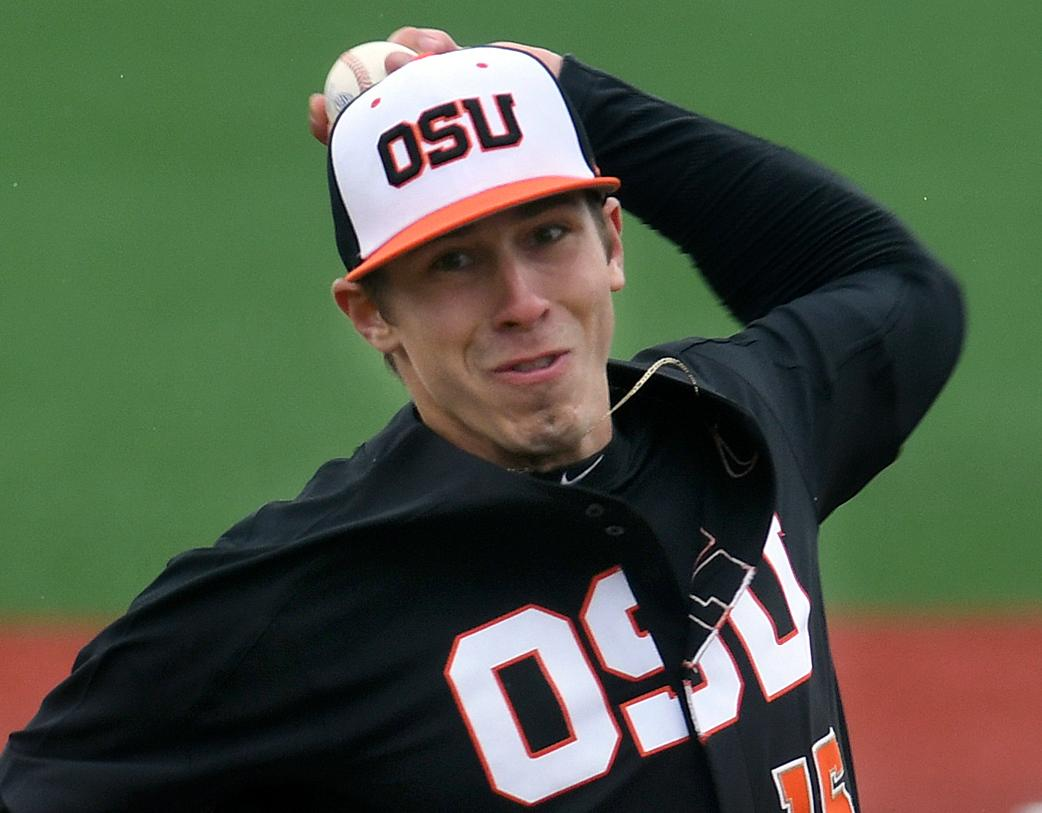FILE - In this March 4, 2017, file photo, Oregon State pitcher Luke Heimlich throws during an NCAA college baseball game against UC Davis in Corvallis, Ore. Heimlich, who as a teenager pleaded guilty to molesting a 6-year-old girl, will not accompany the Beavers to the College World Series. The 21-year-old left-hander made the announcement in a statement released through a representative for his family. He called going to the series something that he and his teammates have worked toward all year.. (Mark Ylen/Albany Democrat-Herald via AP, File)