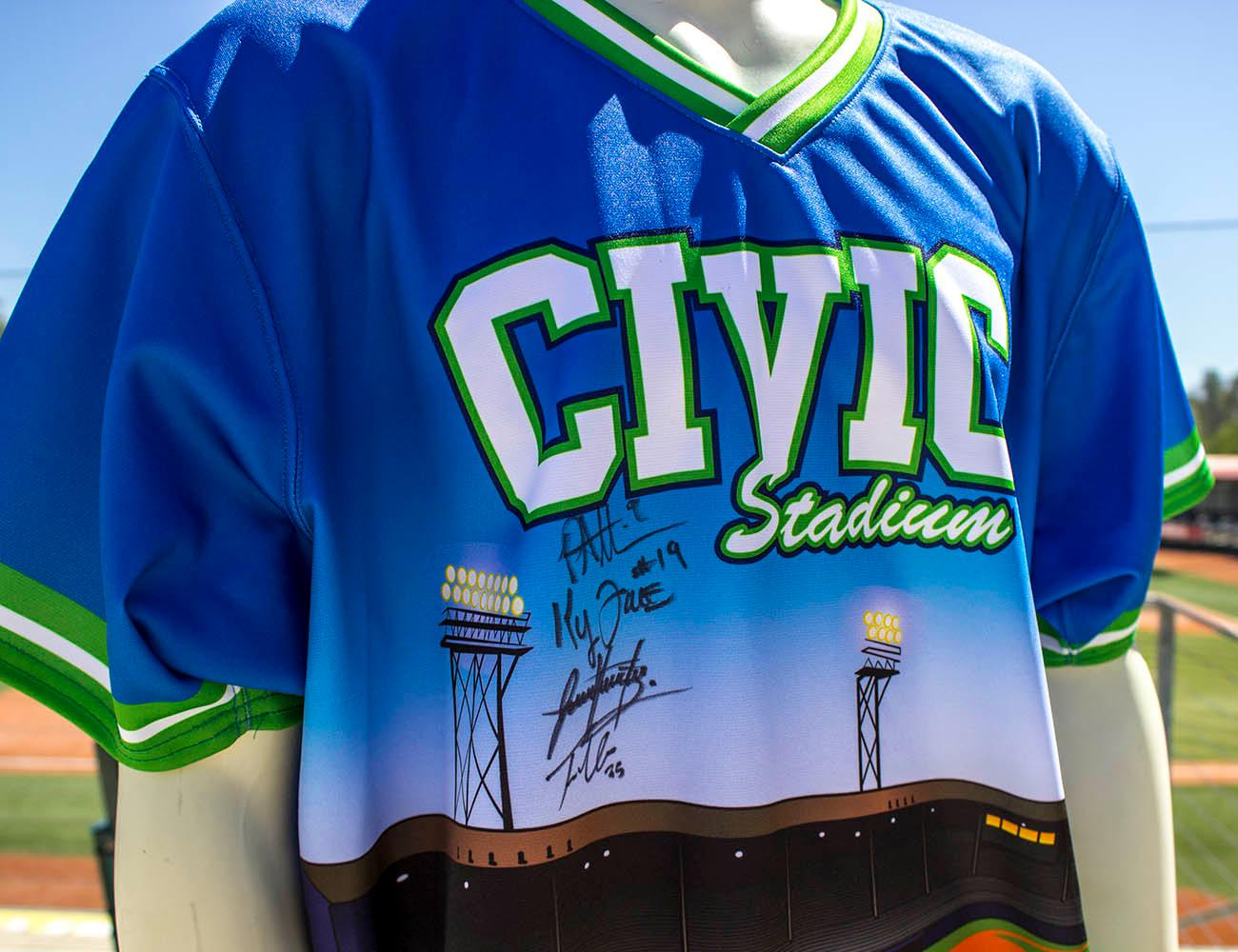 Shortly after Civic Stadium burned down, graphic designer Danny Cowley created this design for Civic Night. That night, the Eugene Emeralds threw a no-hitter. Cowley says he will always associate that memory with the jersey and he asked all four pitchers who played that night to sign this jersey. The Eugene Emeralds will hold a Throwback Thursday and Teacher Appreciation Night August 18. Teachers can get free box seats. (Photo by Amanda Butt)