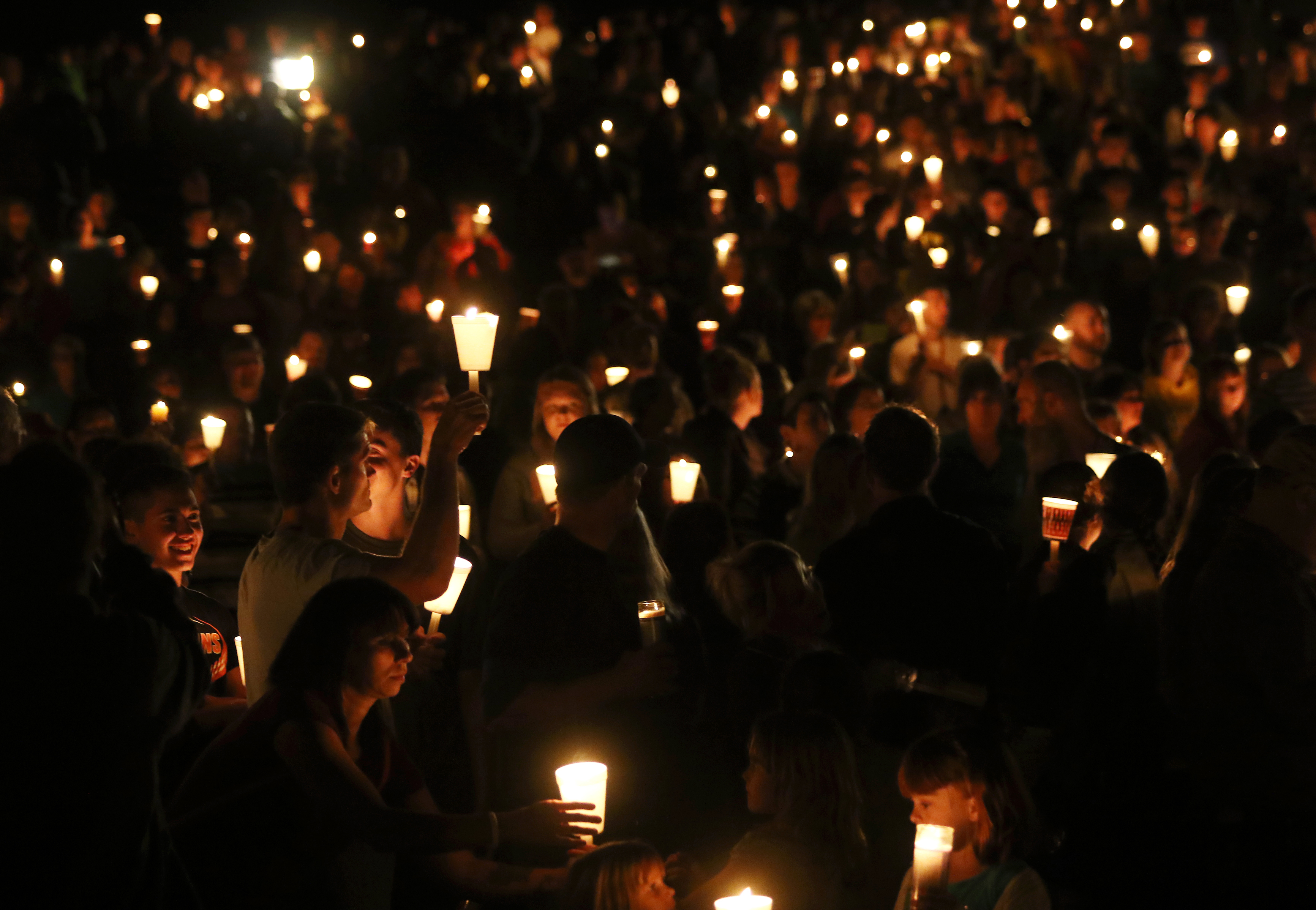 Community members attends a candlelight vigil for those killed during a shooting at Umpqua Community College in Roseburg, Ore., Thursday, Oct. 1, 2015. (Michael Sullivan/The News-Review via AP) MANDATORY CREDIT