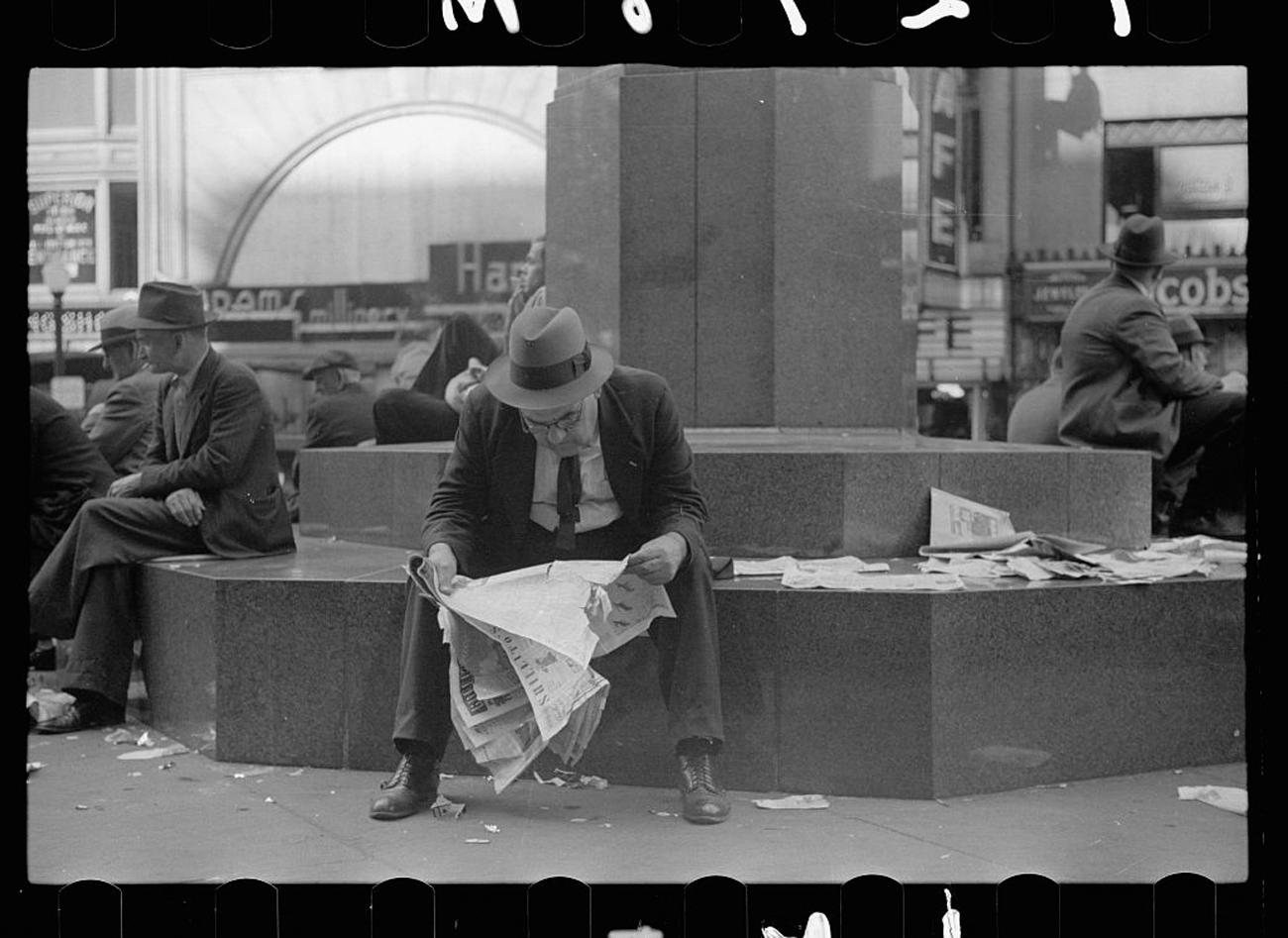 """Man reading newspaper in Fountain Square, Cincinnati, Ohio"" in{ }October 1938{ }/ Image: John Vachon for the U.S. Farm Security Administration/Office of War Information accessed via the Library of Congress Archives // Published: 3.4.19"