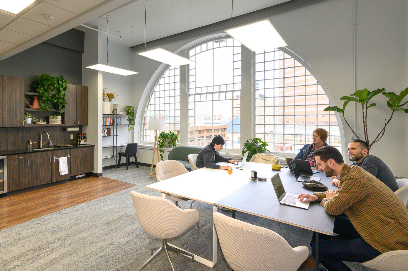 Cincinnati's Novel Coworking space already has many tenants who work from private offices and suites daily. Companies like Turner Construction, Ninjology, BS LLC (pictured), and Valvoline all have people working from within Novel's private offices. At the time of this writing, private offices begin at $549 per month and include access to Novel's espresso bar, local draft beer on tap, fiber internet, mail service, and more. Leasees have their business' logo emblazoned on their door, which is locked by keypad for security. / Image: Phil Armstrong, Cincinnati Refined // Published: 2.11.20