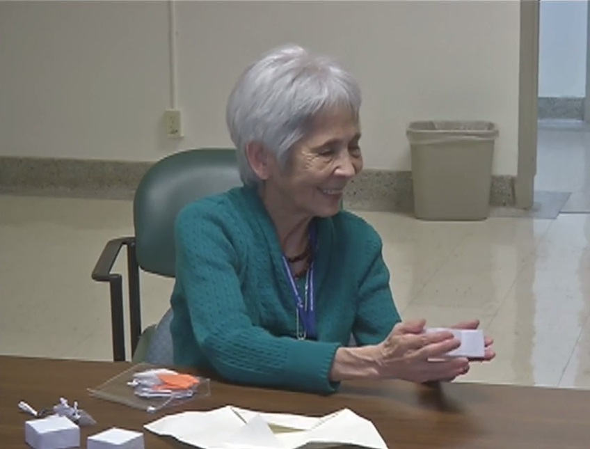 "80-year-old Kazuko Renes, also known as ""Grandma,"" teaches veterans origami without seeing their creations or faces. (SBG photo)"