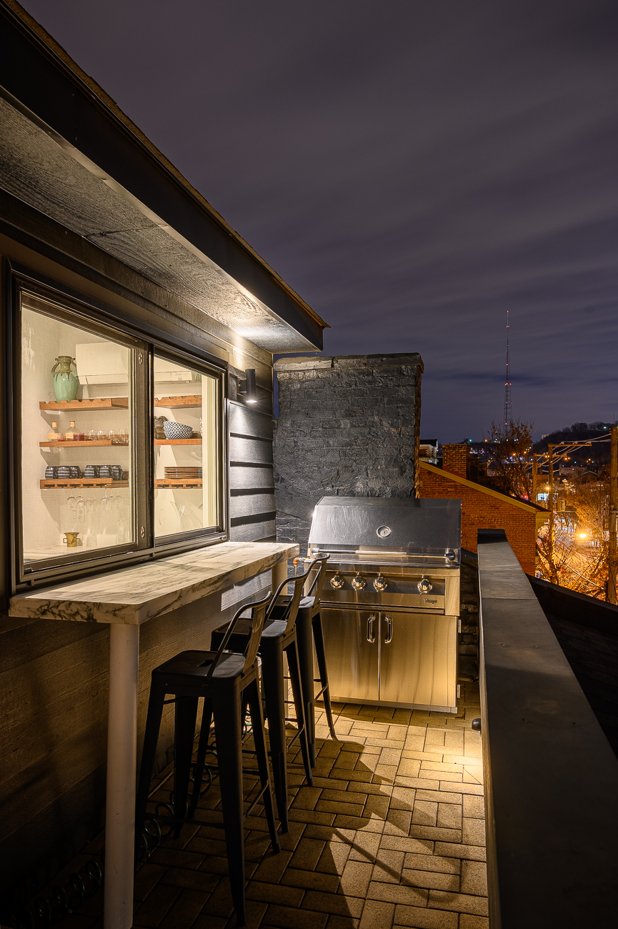 The window opens to allow passthrough from or to the grill on the rooftop. Inside is a kitchenette. / Image: Phil Armstrong // Published: 12.6.19