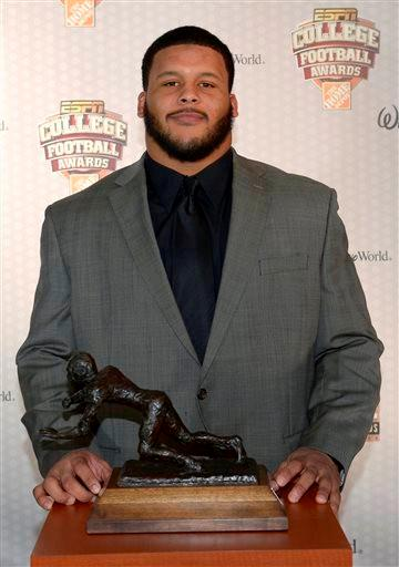Pittsburgh defensive tackle Aaron Donald poses with the Outland Trophy after winning the honor during the College Football Awards show in Lake Buena Vista, Fla., Thursday, Dec. 12, 2013.