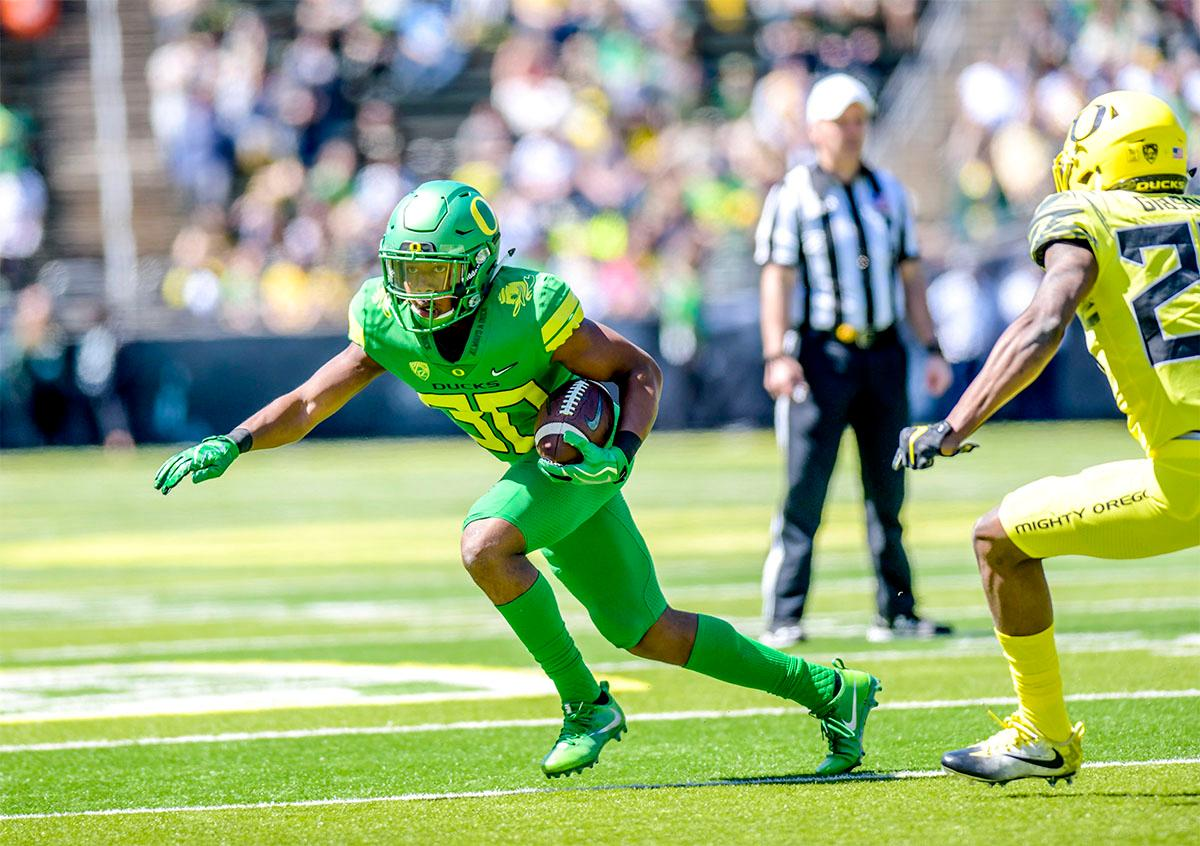 The Thunder's Jaylon Redd (#30) looks for openings as he runs the ball down field. The Thunder defeated the Lightning 59-24 in the Spring Game on Saturday at Autzen Stadium. Photo by August Frank