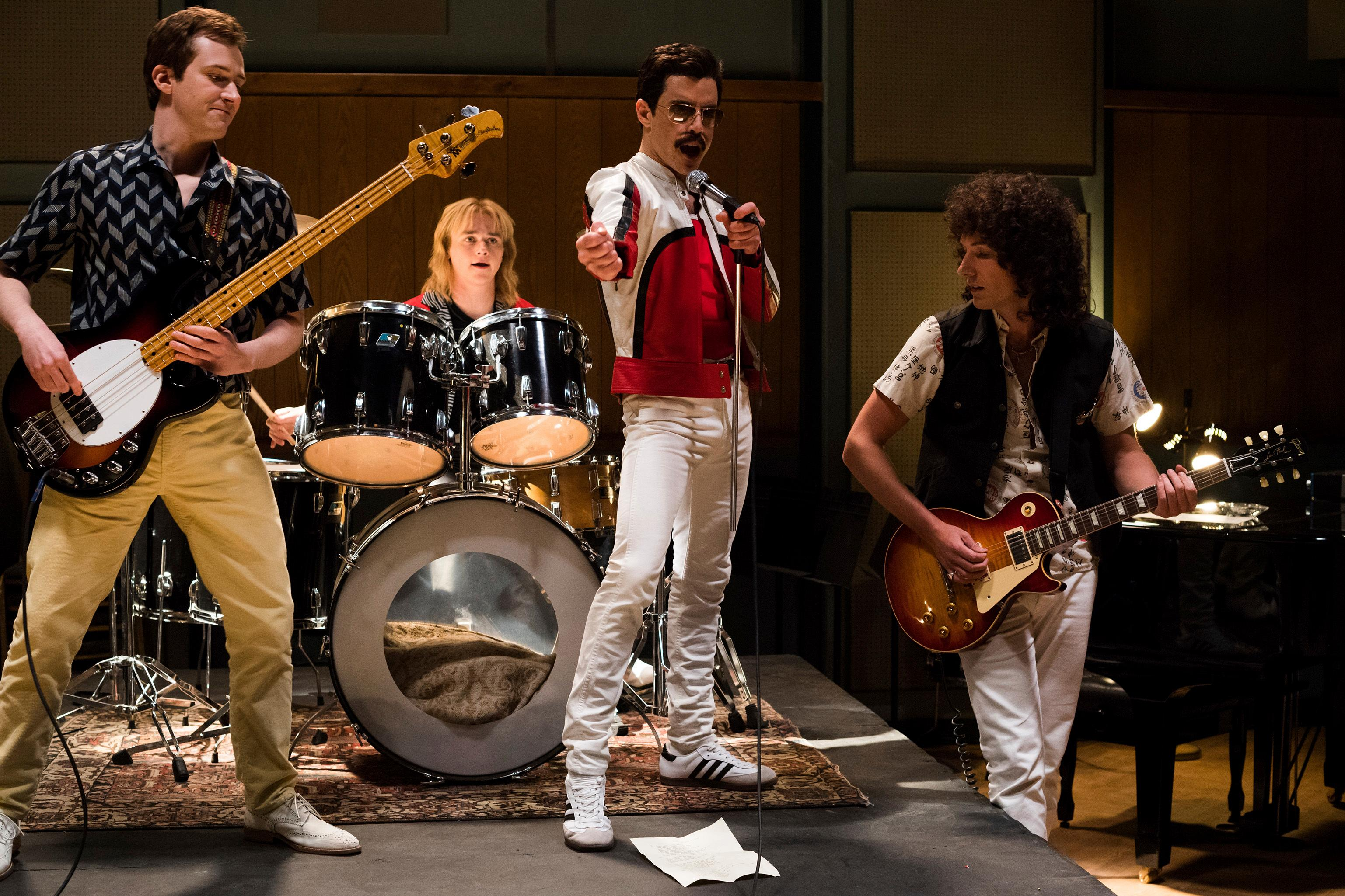 "This image released by Twentieth Century Fox shows Joe Mazzello, from left, Ben Hardy, Rami Malek and Gwilym Lee in a scene from ""Bohemian Rhapsody."" (Alex Bailey/Twentieth Century Fox via AP)"