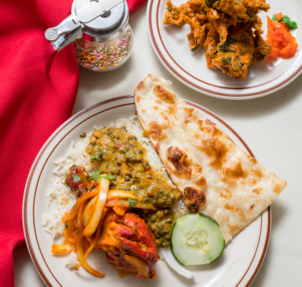 Palak pakora, curry chicken, nan, and fennel sews / Image: Marlene Rounds // Published: 10.25.18