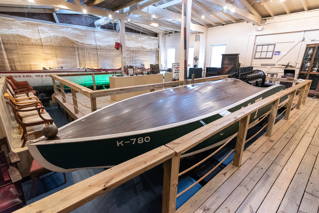 Arguably the museum's most prized piece in the collection is J.W. Whitlock's 'Hoosier Boy.' The hydroplane race boat, which was originally built in 1915, is considered the prototype for modern-day racing boats and still holds the record for the fastest roundtrip journey between Cincinnati and Louisville. The boat in the museum is the 4th iteration (built in the 1920s) of the Hoosier Boy. Whitlock outfitted it with a Liberty Aircraft engine to give it the necessary speed required to travel at such high speeds on the water. There's an unofficial agreement with the Smithsonian to send it to Washington D.C. should the Rising Sun museum ever discontinue. / Image: Phil Armstrong, Cincinnati Refined // Published: 1.7.20