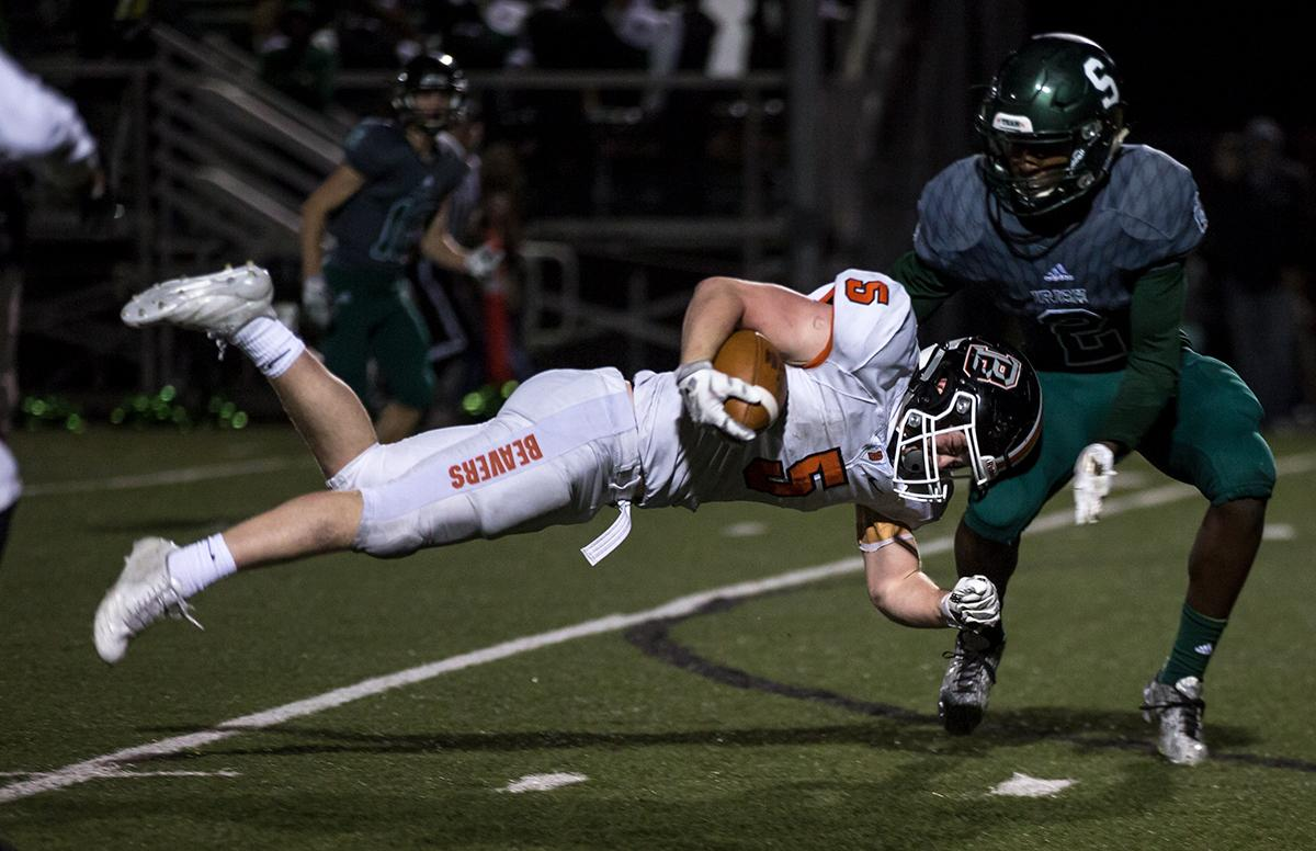 Beaverton wide receiver Trevor McDonald (#5) is brought down before he could attempt to dodge Sheldon's Raymond Woodie (#2). The Sheldon Irish defeated the Beaverton Beavers 48 - 7 at Sheldon High School on Friday, November 3, to win the first round of the state playoffs. Photo by Kit MacAvoy, Oregon News Lab