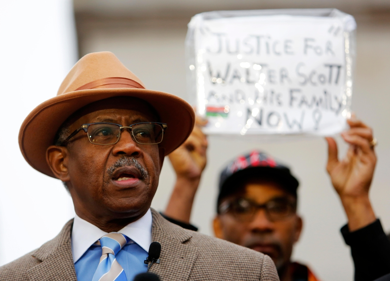 The Rev. Nelson B. Rivers III, with the National Action Network, speaks during a prayer vigil in front of the Charleston County Courthouse as the jury deliberates in the Michael Slager trial Monday, Dec. 5, 2016, in Charleston, S.C. (AP Photo/Mic Smith)