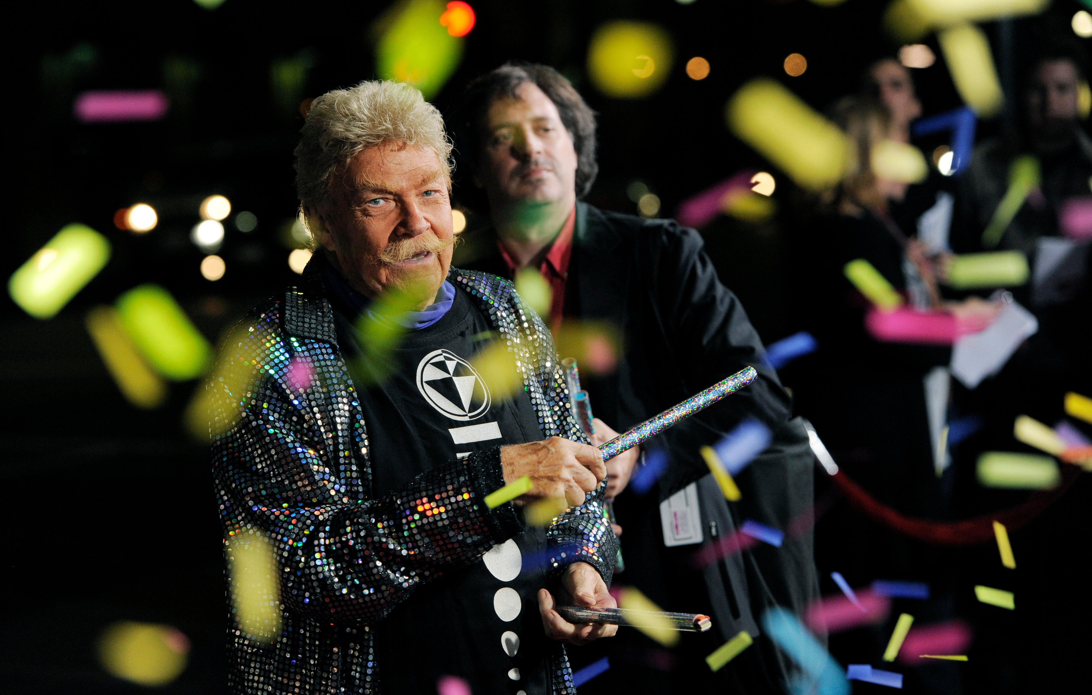 "FILE - In this Wednesday, Oct. 13, 2010, file photo, comedian Rip Taylor throws confetti on photographers at the premiere of the film ""Jackass 3D,"" in Los Angeles. Taylor, the mustached comedian with a fondness for confetti-throwing who became a television game show mainstay in the 1970s, died Sunday, Oct. 6, 2019. He was 84. (AP Photo/Chris Pizzello, File)"