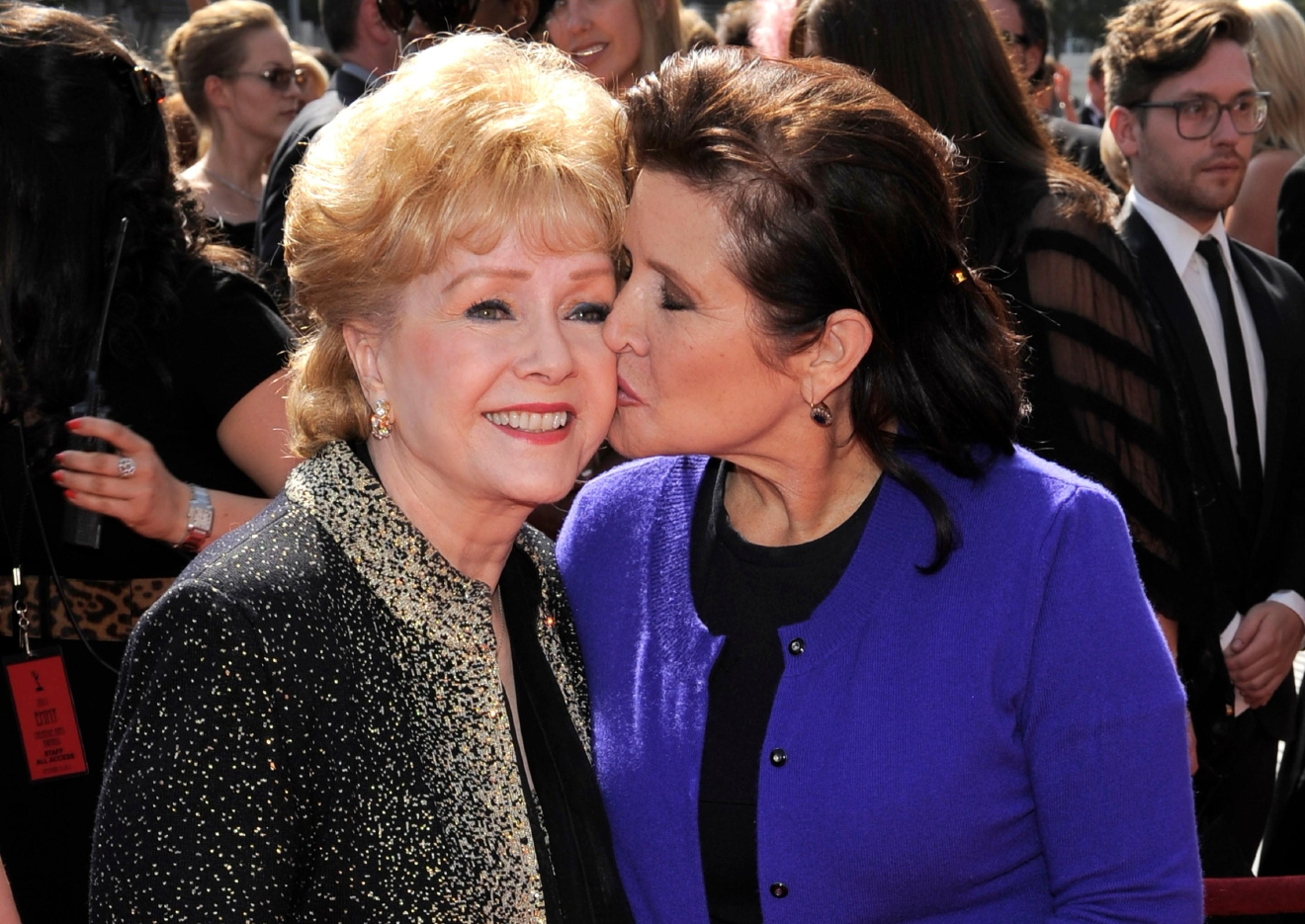 FILE- In this Sept. 10, 2011, file photo, Debbie Reynolds, left, and Carrie Fisher arrive at the Primetime Creative Arts Emmy Awards in Los Angeles. (AP Photo/Chris Pizzello, File)