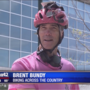 Man bikes through Omaha during cross country trek for breast cancer awareness