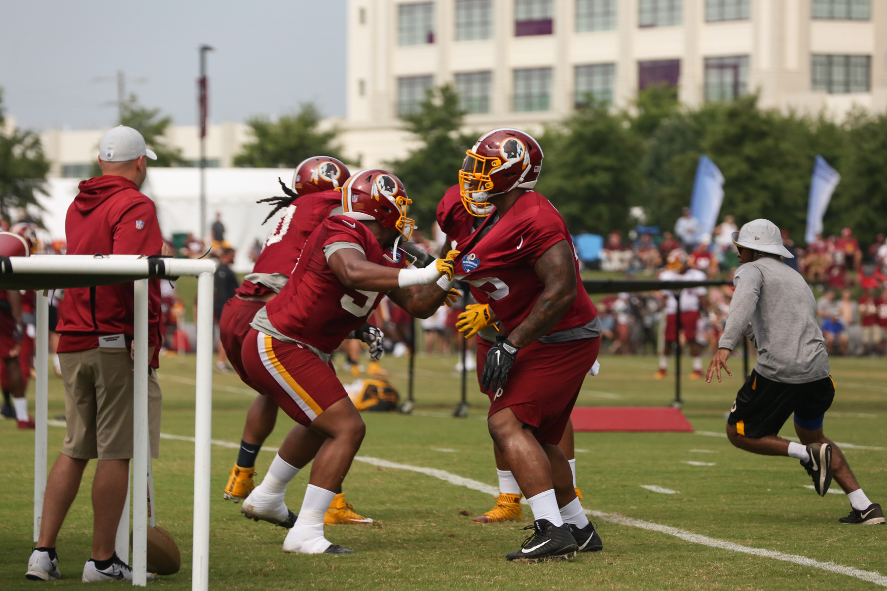 Spirits were high as fans cheered on the Washington Redskins and their recruits in Richmond, Virginia, today for the second day of training camp. Parts of the camp are open to the public, meaning fans flocked to watch the players stretch out, run drills and work out plays for the coming season. (Amanda Andrade-Rhoades/DC Refined)