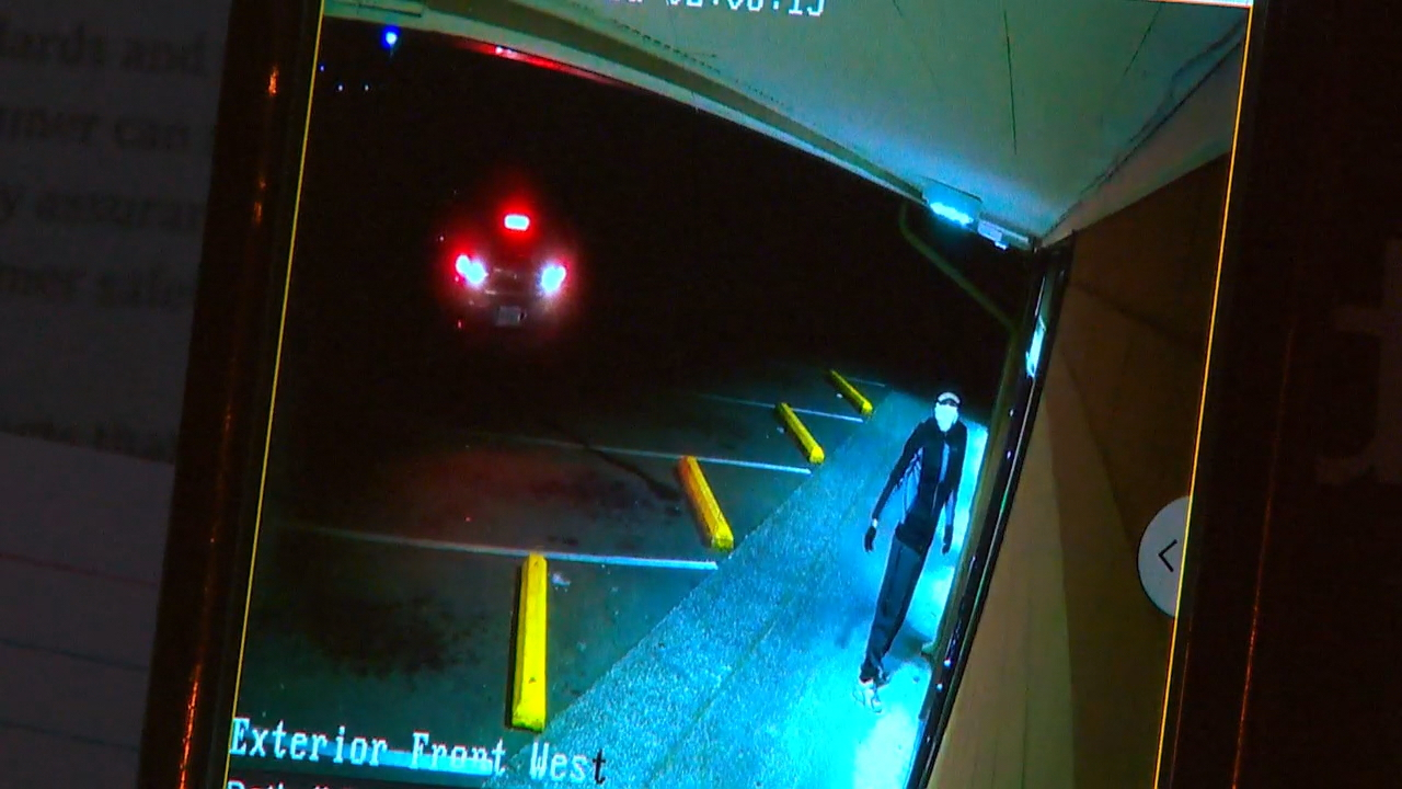 Screenshot from surveillance video shows the car outside the store before crashing through the entrance.<p></p>