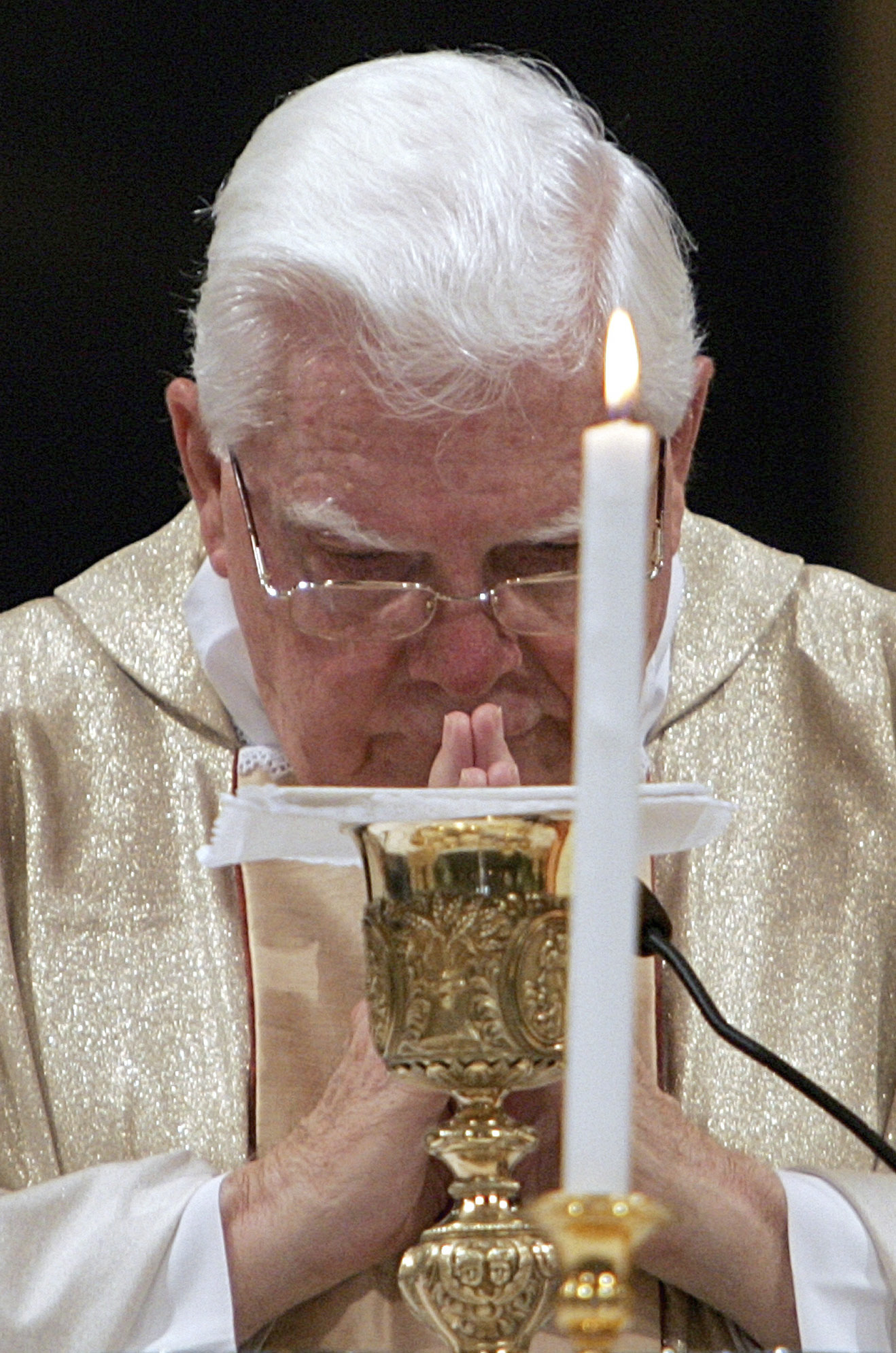 FILE - In this Thursday, Aug. 5, 2004 file photo, Cardinal Bernard Law celebrates Mass during the ceremony for Our Lady of the Snows, in St. Mary Major's Basilica, in Rome, Italy. An official with the Catholic Church said Tuesday, Dec. 19, 2017, that Law, the disgraced former archbishop of Boston, has died at 86. Law stepped down under pressure in 2002 over his handling of clergy sex abuse cases. (AP Photo/Domenico Stinellis, File)