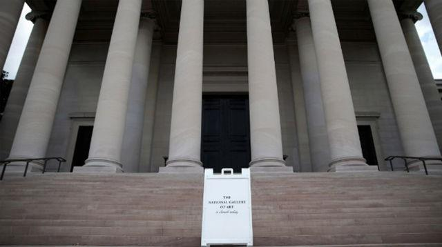 A sign alerting visitors that the National Gallery of Art is closed stands outside the building on October 1.