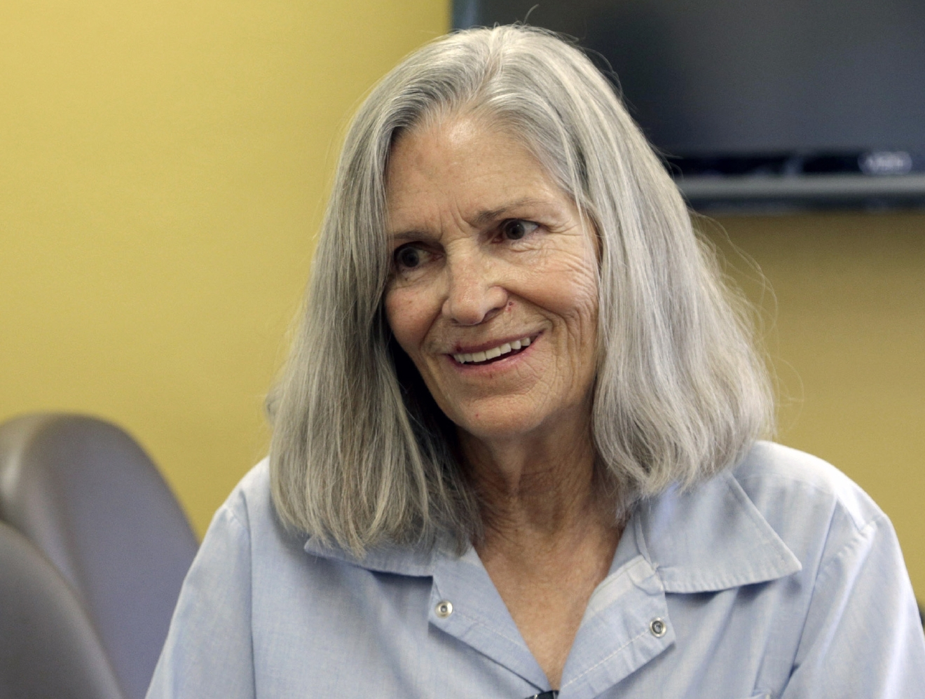 FILE - In this April 14, 2016 file photo, former Charles Manson follower Leslie Van Houten confers with her attorney Rich Pfeiffer, not shown, during a break from her hearing before the California Board of Parole Hearings at the California Institution for Women in Chino, Calif. A judge has upheld Gov. Jerry Brown's decision to keep Charles Manson follower Van Houten in prison. Los Angeles County Superior Court Judge William Ryan on Thursday, Oct. 6, 2016, refused a request from Van Houten's lawyer to overturn Brown's decision. A state board in April had declared Van Houten, who killed a California couple more than 40 years ago, eligible for parole after years of good prison behavior. (AP Photo/Nick Ut, File)