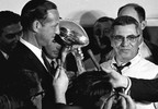 In this Jan. 15, 1967 file photo, football commissioner Pete Rozelle, left, presents the trophy to Green Bay Packers coach Vince Lombardi after they beat the Kansas City Chiefs in the Super Bowl in Los Angeles.