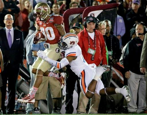 Florida State's Rashad Greene catches a pass in front of Auburn's Ryan White (19) during the first half of the NCAA BCS National Championship college football game Monday, Jan. 6, 2014, in Pasadena, Calif.