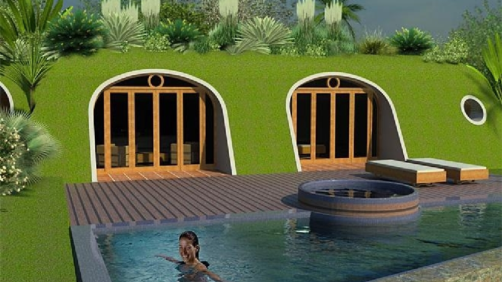 Photos company builds 39 hobbit houses 39 you can live in komo for Company that builds houses