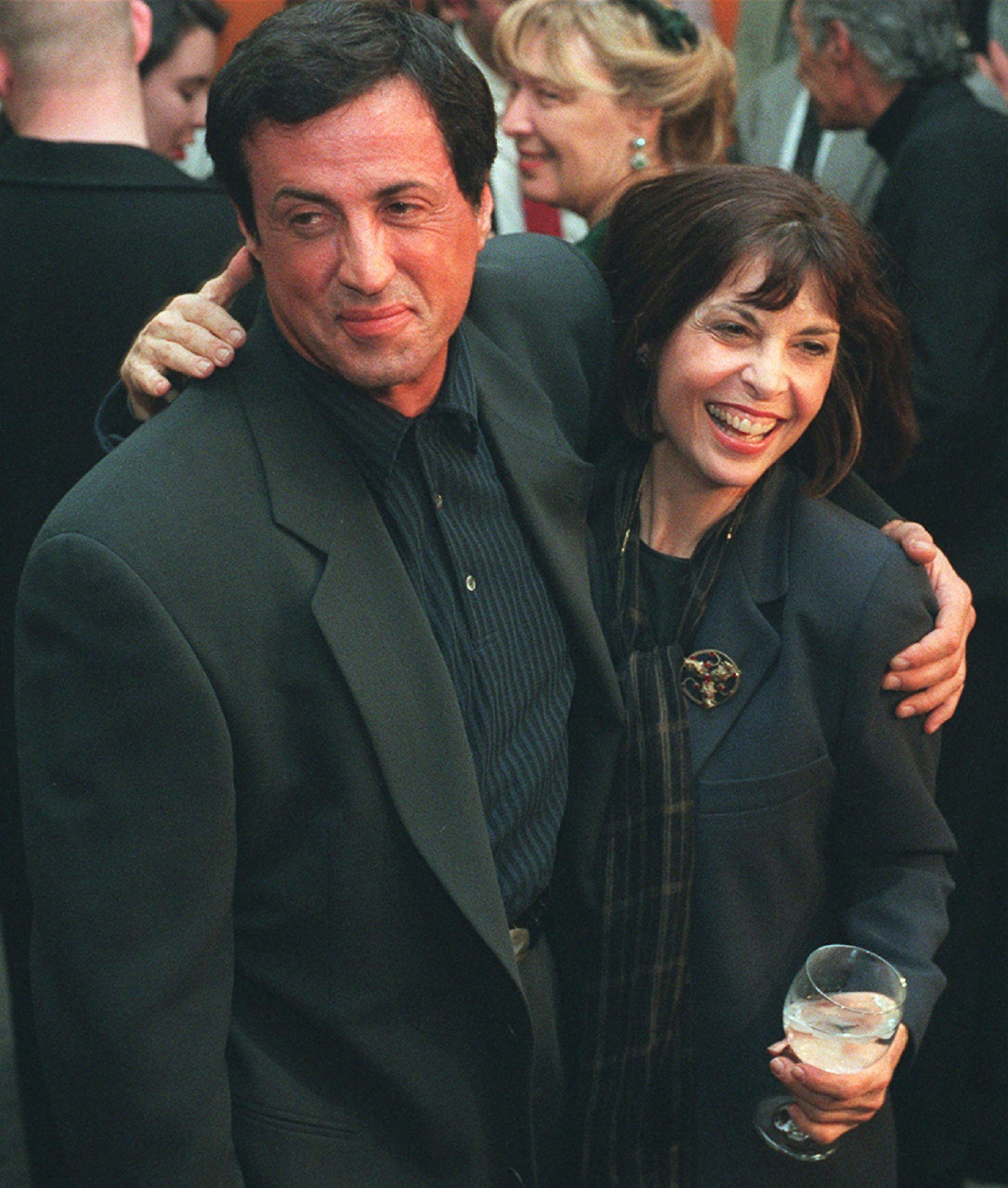 "FILE – In this Nov. 15, 1996, file photo, actor and screenwriter Sylvester Stallone, left, poses with ""Rocky"" co-star Talia Shire before a screening of the film to mark its 20th anniversary at the Academy of Motion Picture Arts and Sciences in Beverly Hills, Calif. Four decades after the Nov. 21, 1976, premiere of ""Rocky,"" the movie's reach is international, and the title character's underdog tale of determination, grit and sleepy-eyed charm still resonates with fans. (AP Photo/Chris Pizzello, File)"