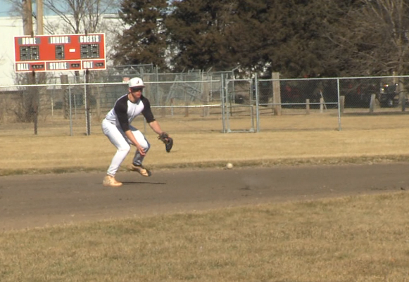 Grand Island senior shortstop Shay Schanaman fields a grounder during a practice (KHGI)