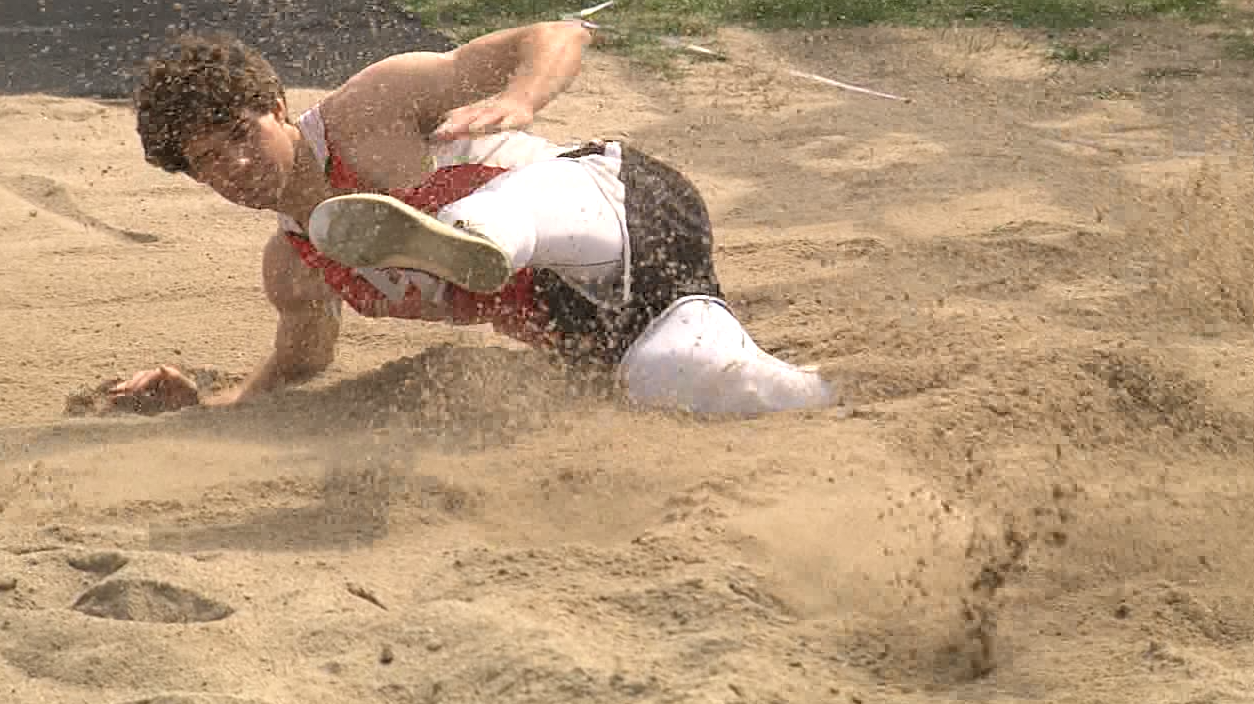 Dylan Reynolds of Broken Bow sets a new school record long jump of 22 feet 10 inches at the Marsh Beck Invite in Minden, April 13, 2017 (NTV News)