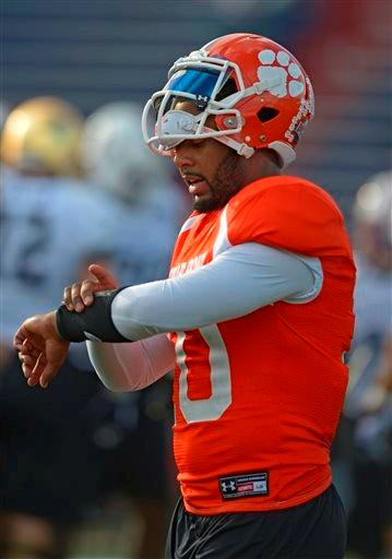 North Squad quarterback Tajh Boyd of Clemson (10) checks his armbands during Senior Bowl practice at Ladd-Peebles Stadium, Monday, Jan. 20, 2014, in Mobile, Ala.