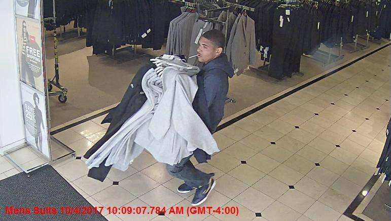 Two people are accused of stealing tons of clothes from Macy's at The Mall in Columbia and running out (Courtesy: Howard County Police)