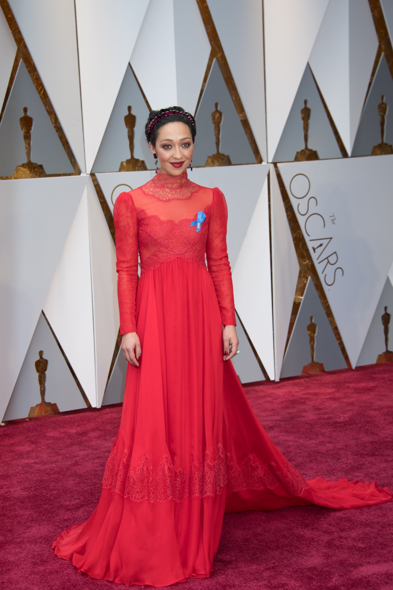 #39: Ruth Negga. We love the color red on Ruth, but in our opinion the high lace neck just goes a little too far. (Image: AMPAS)
