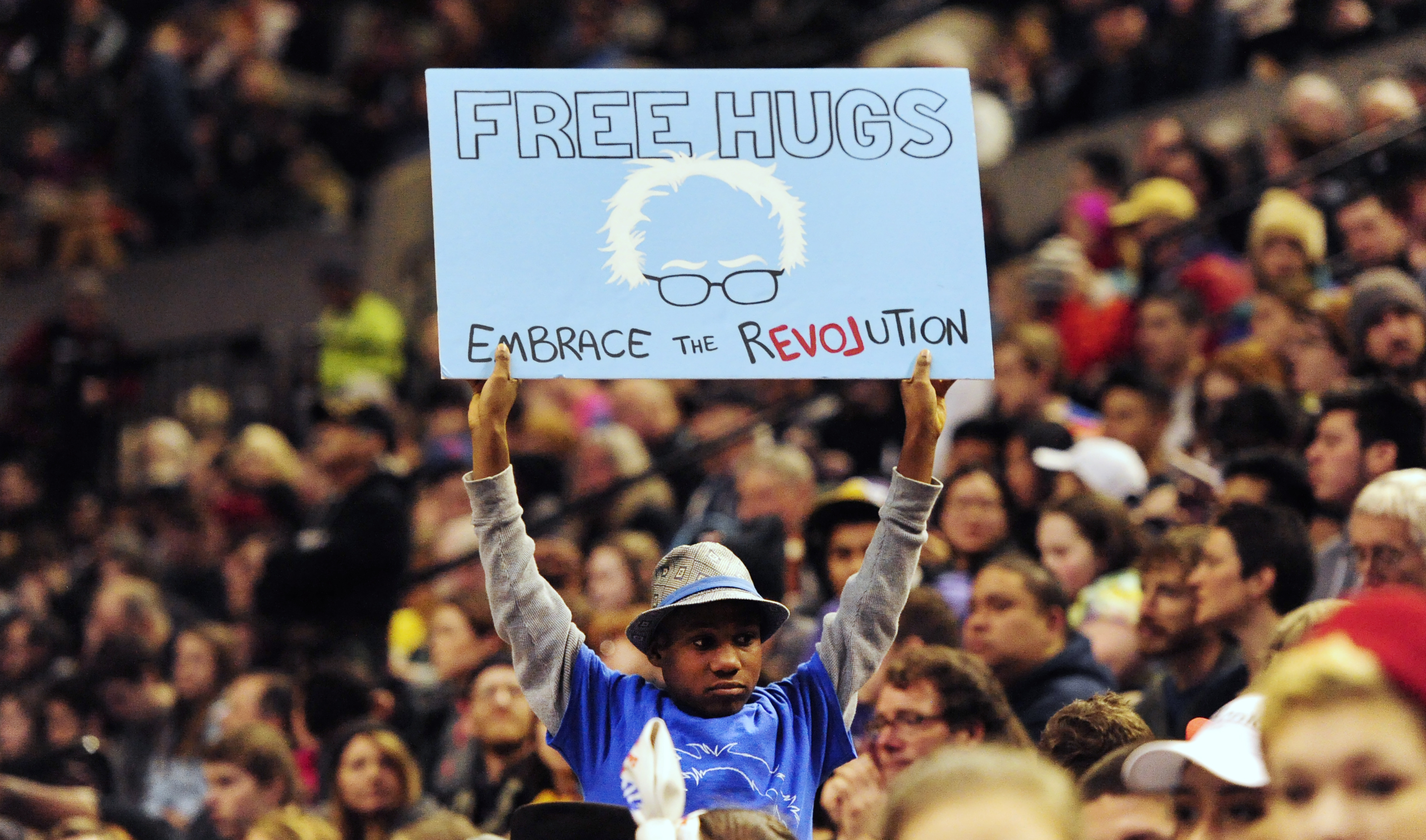 This photo taken March 25, 2016, shows a young supporter holding up a sign as then Democratic presidential candidate Bernie Sanders, I-Vt., addressed the crowd during a rally at the Moda Center in Portland, Ore.(Steve Dykes/The Oregonian via AP)
