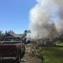 Firefighters put out house fire in Naches that is thought to have started in the garage