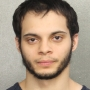Prosecutors: Airport shooter needs to stay in jail to ensure public safety