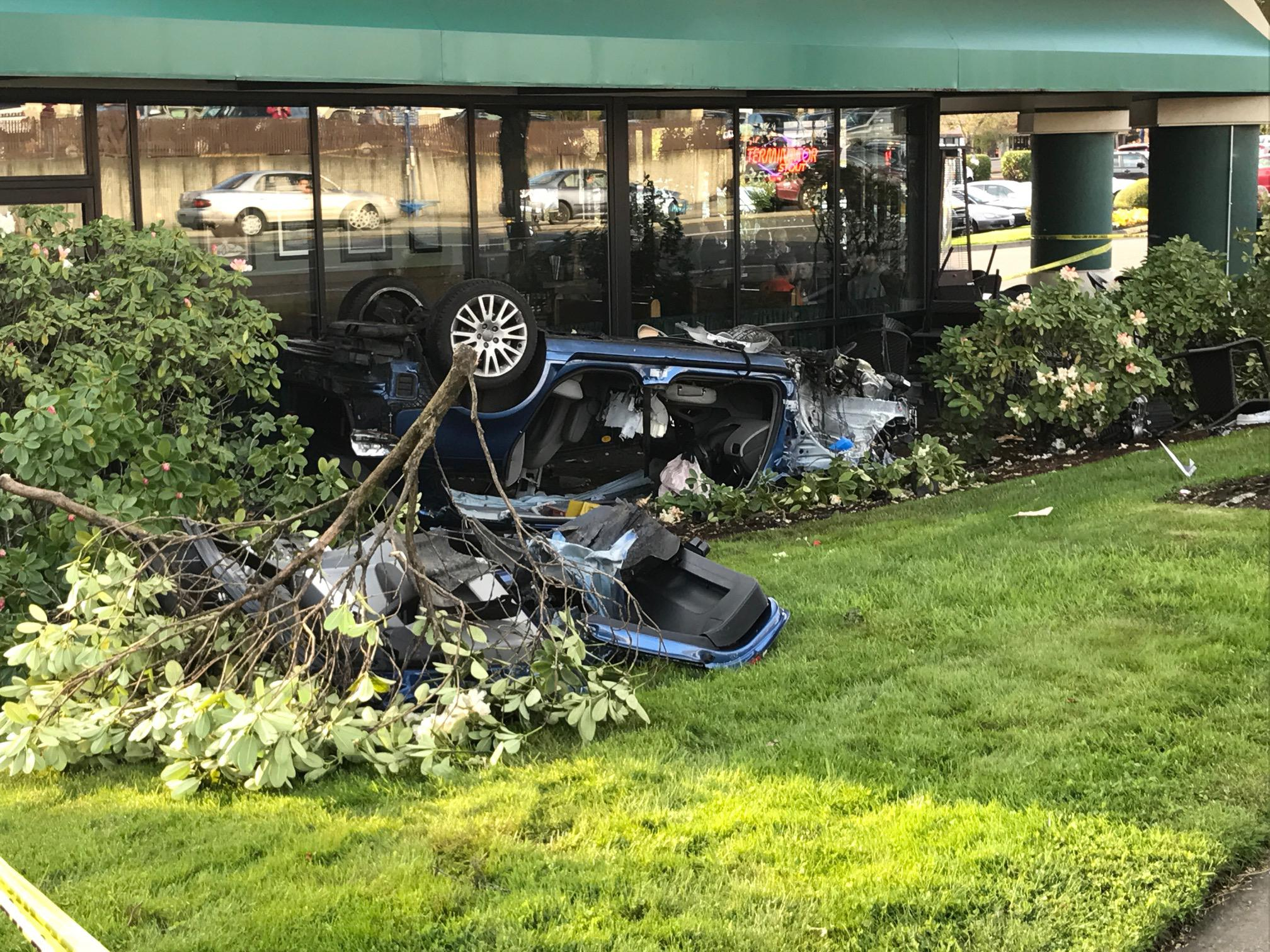 A driver rolled this car Tuesday, April 18, 2017 and hit a bicyclist and a person outside this McMenamins brewpub on Southwest Murray and Allen in Beaverton. The driver was also injured. (Photo: Lincoln Graves)