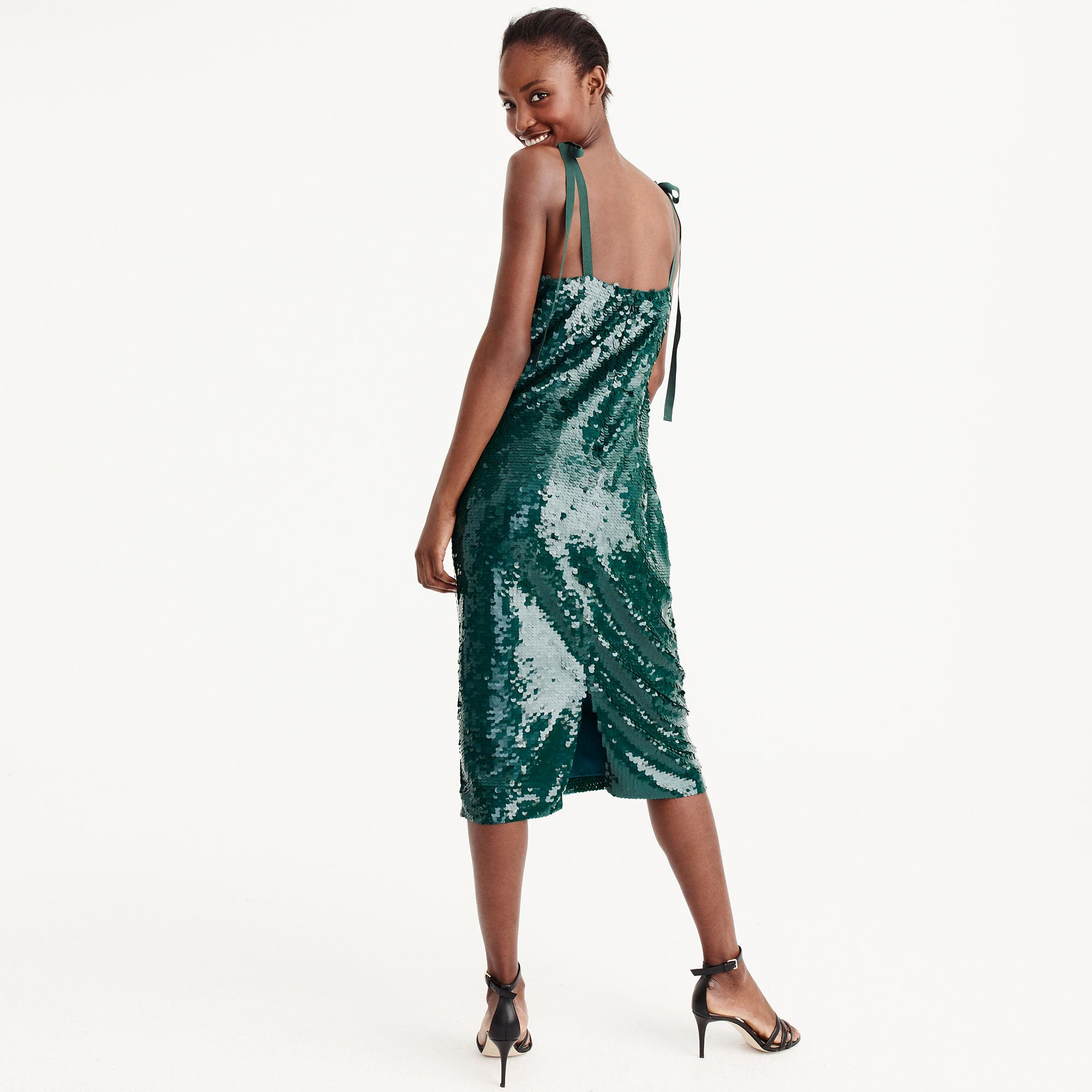 <p>Collection tie-shoulder sequin dress - $298. I can't get enough of this collection tie-shoulder sequin dress.{&amp;nbsp;} Pair with some open toed heels, pink lips and a romantic up-do.{&amp;nbsp;} (Image: JCrew){&amp;nbsp;}</p><p></p>