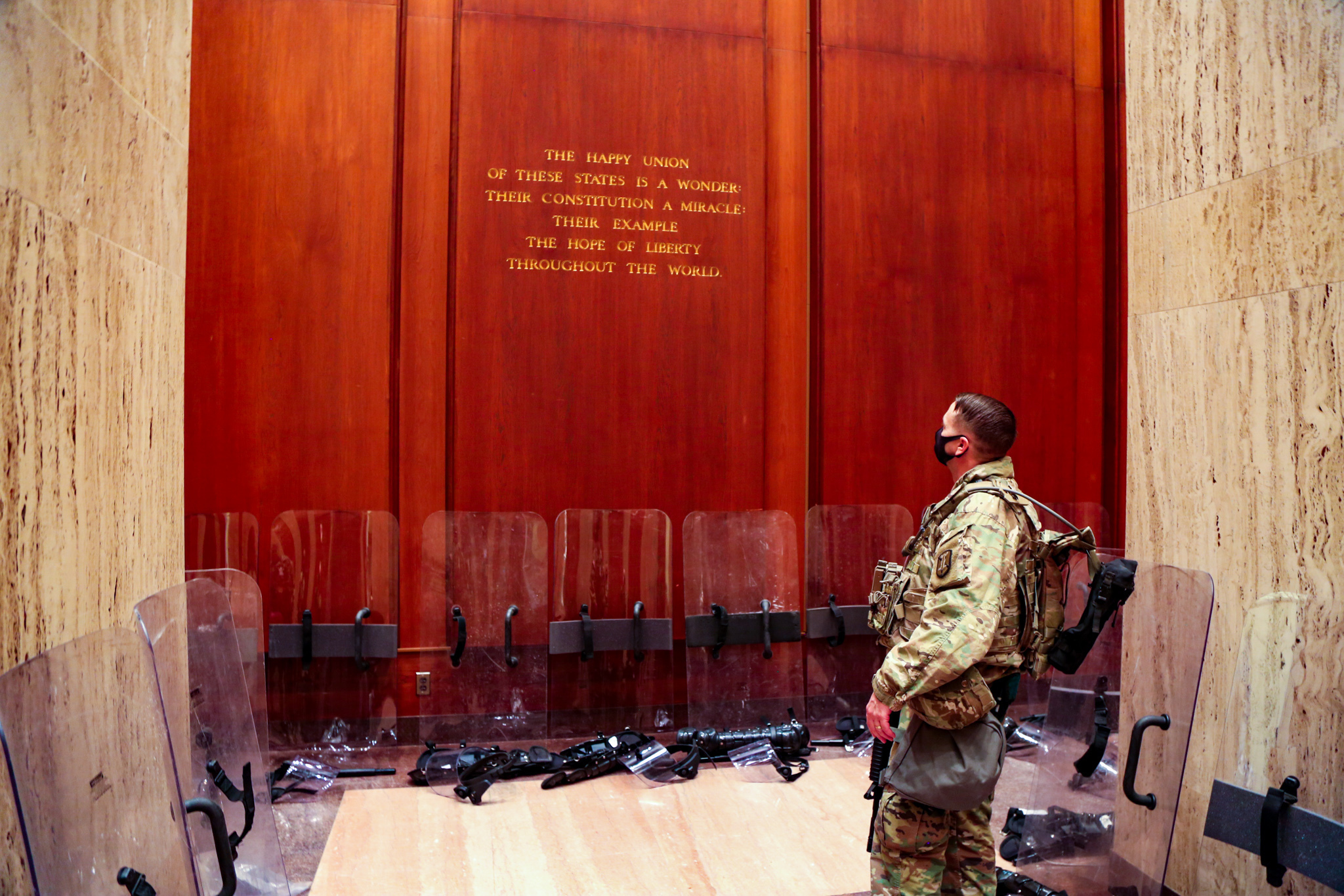 A U.S. Soldier with the Utah National Guard, reads a quote on the wall of the James Madison Building, Jan.18, 2021. At least 25,000 National Guard men and women have been authorized to conduct security, communication and logistical missions in support of federal and District authorities leading up and through the 59th Presidential Inauguration. (U.S. Army National Guard photo by Spc. Christopher Hall)